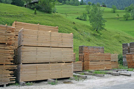 sawmill: pile of lumber cut into boards and stacked in a sawmill