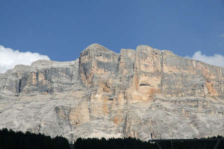 nuances: massive Rocky wall with orange nuances of the Dolomites in Italy