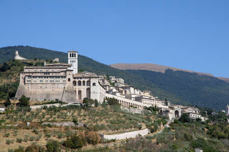 franciscan: imposing Basilica of Assisi perched on the Hill in umbria in Italy Stock Photo