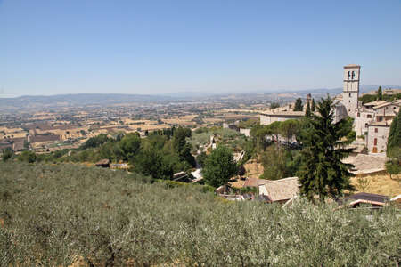 st  francis: Panorama of the city of Assisi and the plain of the Umbria region in summer Stock Photo