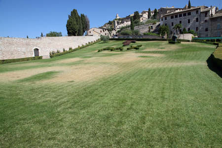 exceptional garden in front of the Basilica of Assisi with Tau and Pax in grass photo