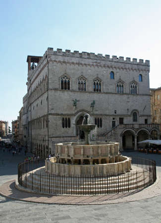 priori: Ancient Fontana Maggiore and the Town Hall in the city of Perugia Stock Photo