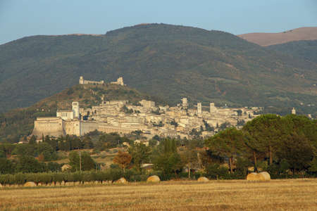 splendid views of the town of Assisi at dusk in umbria photo