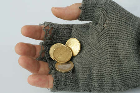 marginalized: hand into the glove of a poor beggar