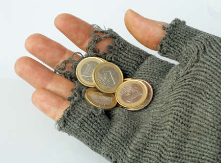 marginalized: poor man collects alms from a few Euros in his glove Stock Photo