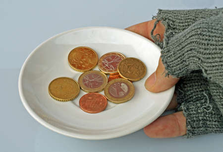 vagabond: white saucer with coins inside held by a poor man