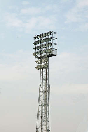 lumens: Lighthouse tower with a lot of lights to illuminate the football stadium Stock Photo