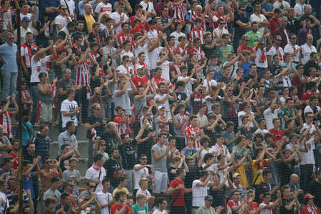 tribune: fans of the football team screaming hymns from the crowded stands Editorial