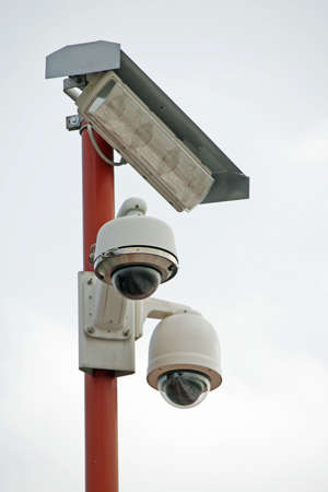 two CCTV cameras and lighting lamp Stock Photo - 15397928