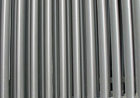 vertical bars: vertical bars of silver an industrial cooler