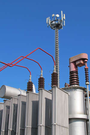 electricity transformer and an antenna for the transmission of signals Stock Photo - 15562256
