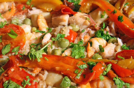 prawn and shrimp with peppers in a rice with seafood photo
