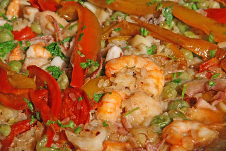 prawn big and shrimp with peppers in rice with seafood photo