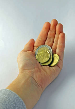 hand of a girl who is holding money in euros