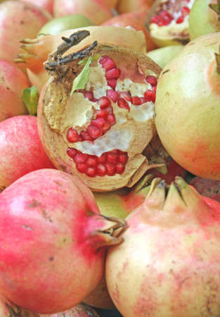 Pomegranate opened with the berries to be tasted in autumn photo