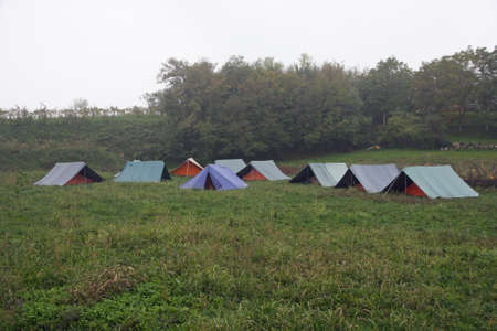 campsite: campsite with tents of boy scouts on a cold winter day
