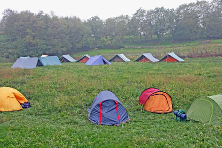 rovers: big campsite with tents of boy scouts on a cold winter day