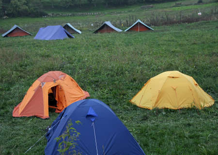 rovers: campsite with many tents in the middle of the lawn on a cold winter day Stock Photo