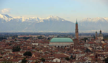 gorgeous view of the city of Vicenza with snow capped mountains in the background the basilica palladiana