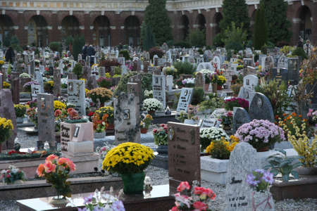 Many Tombs And Gravestones With Flower Vases In A European Cemetery