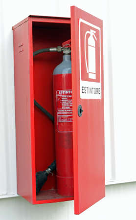 foam safe: Red fire extinguisher to put out the fires in the box on the wall Stock Photo
