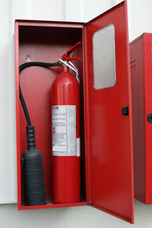 Red fire extinguisher to put out the fires in the box photo