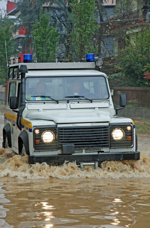 rescue car in a way completely flooded during a flood photo
