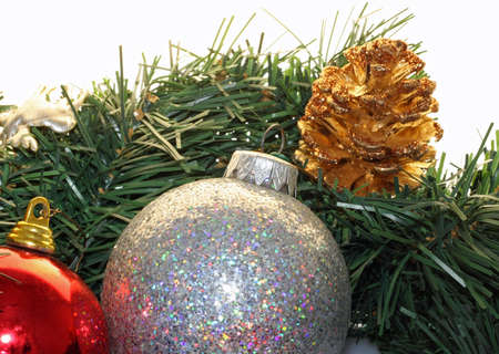 Colored balls and Christmas decorations cutlery on pine needles photo