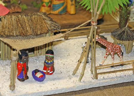 African crib with the Holy Family in a village and giraffe photo