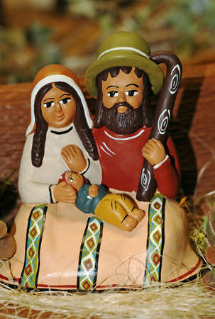presepe: terracotta statues of the Nativity scene with Mary, Jesus, baby ethnic and Saint Joseph with stick Stock Photo