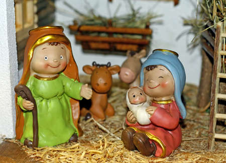 nativity set: statues of smiling a Nativity scene with Holy Family in the Manger