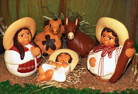 bethlehem crib: Mexican Nativity scene with Holy Family and baby Jesus