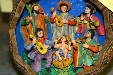 presepe: Italian Nativity scene with Holy Family and guitar players Stock Photo