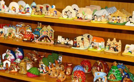 presepio: collection of Nativity scenes on sale in a shelf at Christmas