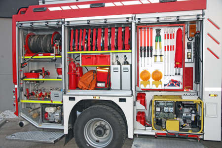 fire car: Emergency equipment inside fire truck Stock Photo