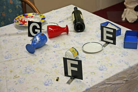 investigated: table with things overturned during a fight and the forensic dentification