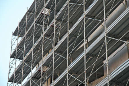 overbuilding: structure of a construction site during construction of a parking lot