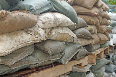 Brown and green sandbags to guard against attacks Stock Photo - 16626180