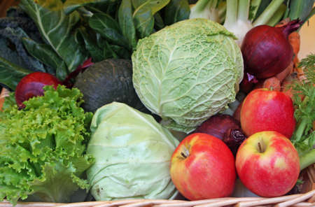 Apple cabbage coleslaw and fresh fruit on sale from greengrocers