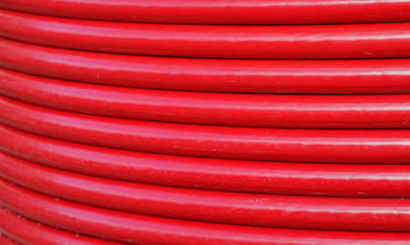 voluminous: Red turns a voluminous lay cable coil