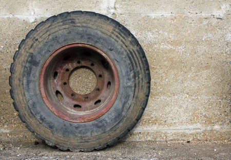 rubber wheel of a big truck resting on the concrete wall Stock Photo - 16625884