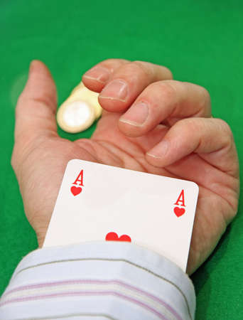 punter: hand of cheating with an ace of hearts in the hole Stock Photo