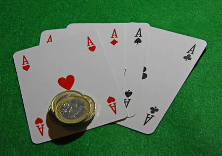 poker of aces with euro coins on green casino table Stock Photo - 16898302