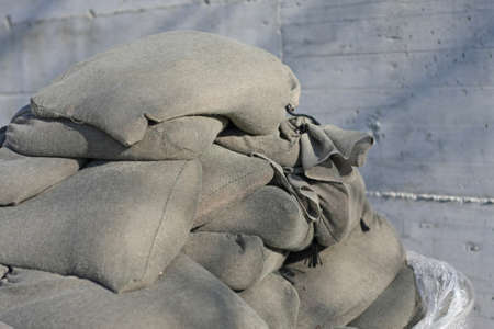 sandbag: bags filled with sand for the construction of a trench in the war zone of war