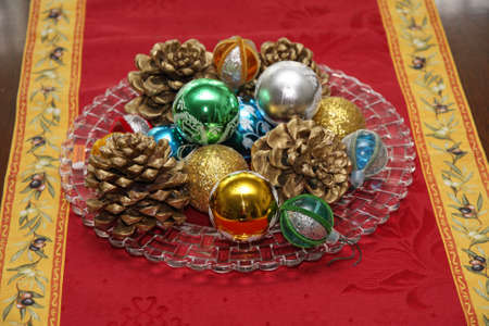 red carpet with a lovely Christmas decor with pine cones and shimmering balls photo