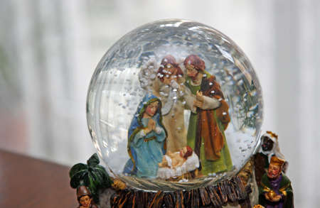nativity set: Nativity with Joseph Mary and baby Jesus in a sphere of water with snow falling