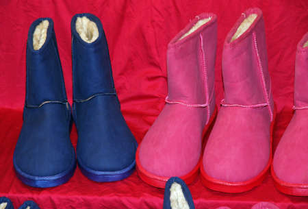 Blue and pink boots for sale at the market photo