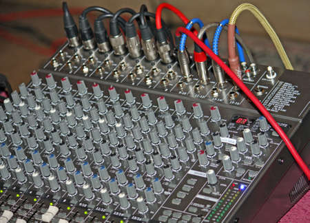complicated sound mixer to adjust the volume during a concert Stock Photo - 17590168