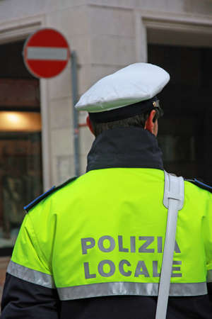 vigilant: policeman in uniform of the municipal police in Italy during a surveillance service Stock Photo