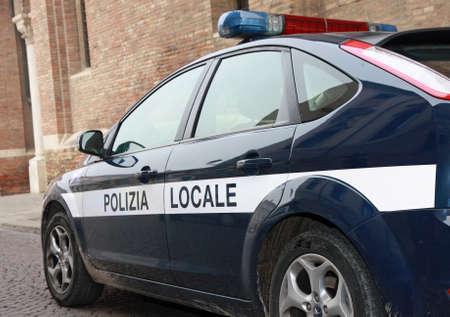 blue municipal police car patrol in a town in Italy Foto de archivo
